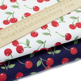 Ivory & Navy Cherry cotton poplin fabric by Rose & Hubble
