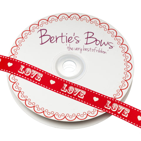 Berties Bows grossgrain ribbon in red with white printed 'Love' design. Perfect ribbon for wedding gifts, invitations and favours.