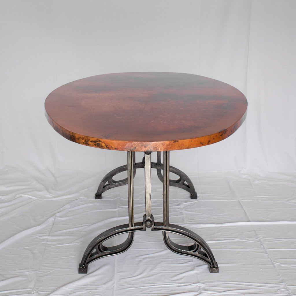 Oval Copper top dining table with iron base