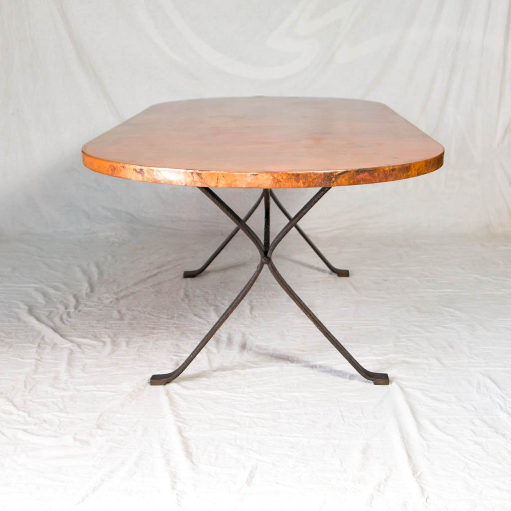iron table base with hammered copper top