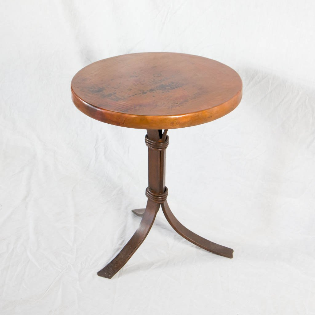 hammered copper top and iron base cocktail table