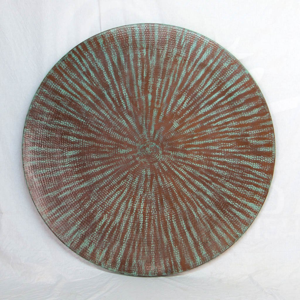 hammered copper table with iron base vestal design