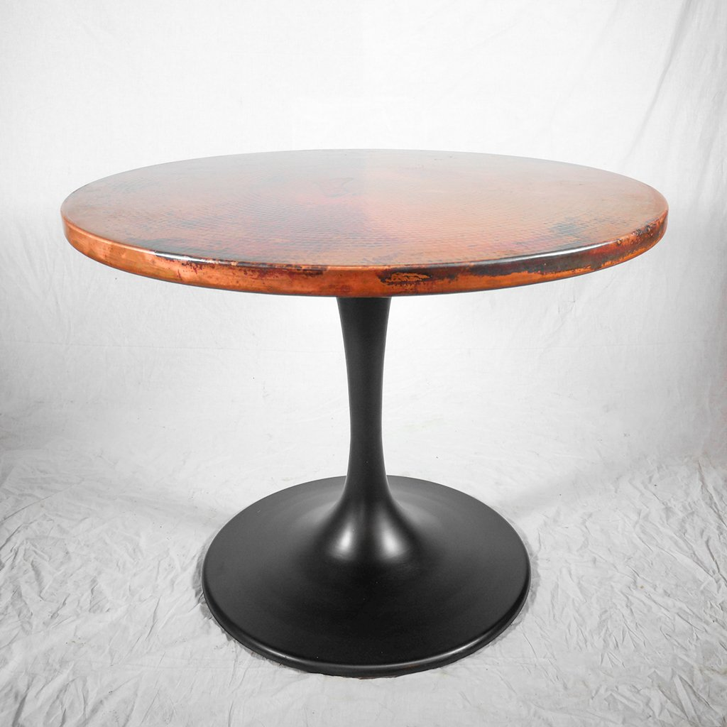 round copper dining table with tulip style base