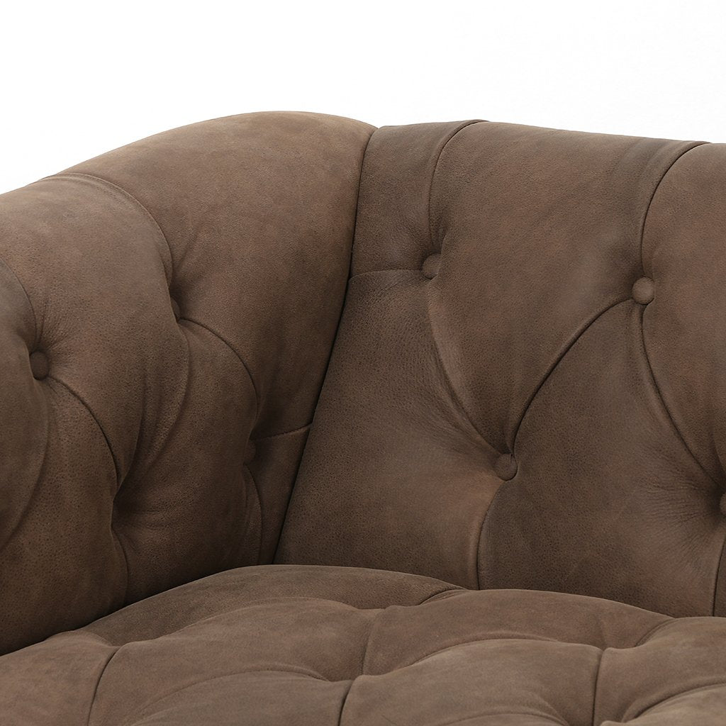 brown leather library style sofa