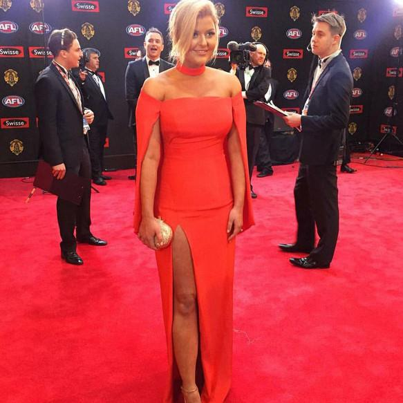 Olga Berg Emma Hawkins wearing Ace Crystal Oval Gold Clutch at the Brownlow Awards