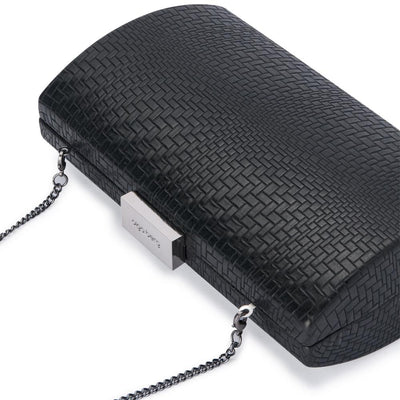 Olga Berg Brooke Woven Embossed Clutch evening bag in Black colourway showing detailed close up