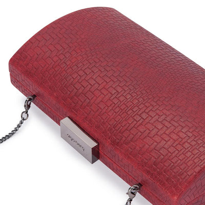 Olga Berg Brooke Woven Embossed Clutch evening bag in Burgundy colourway showing detailed close up