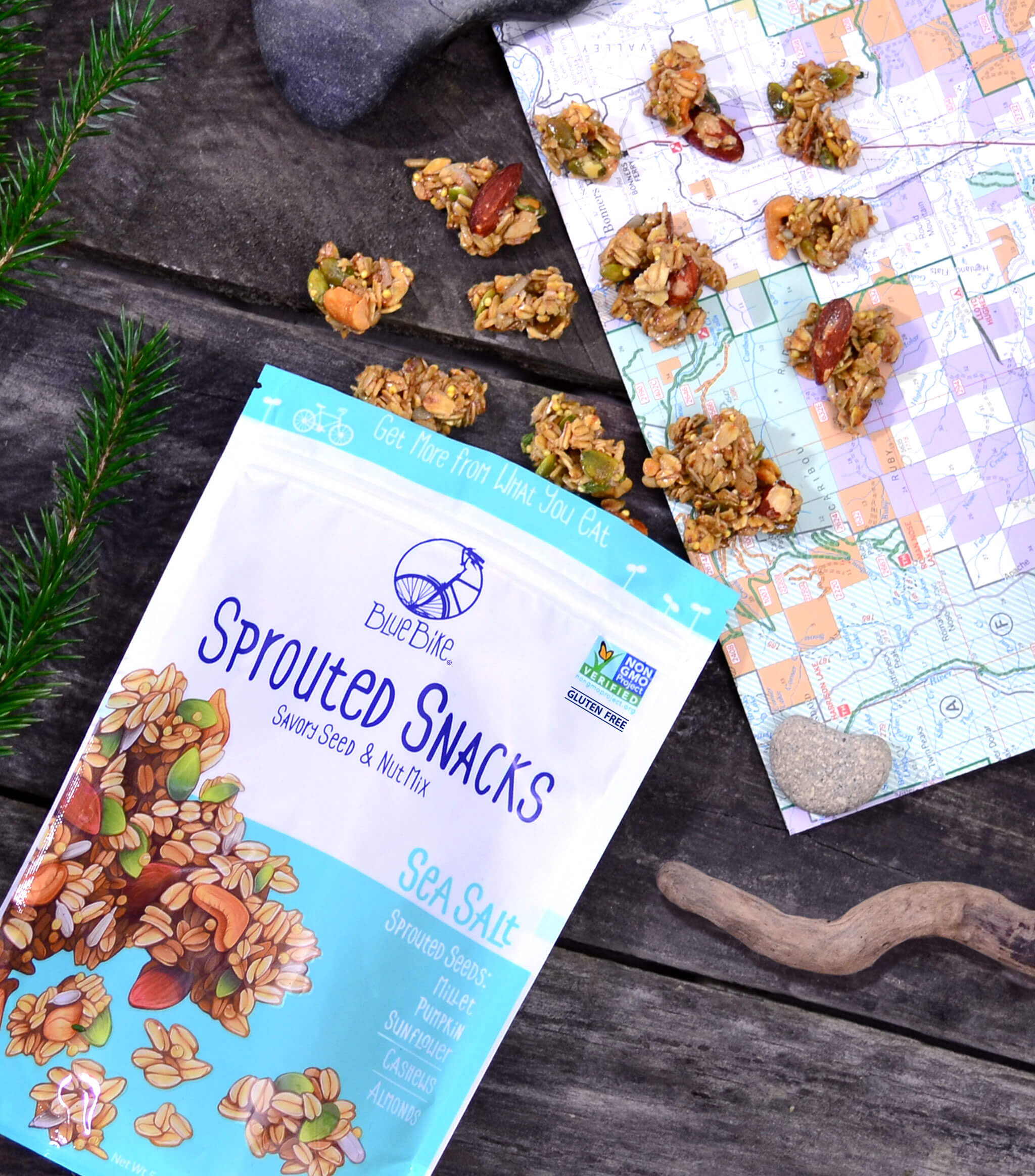 Sea Salt Sprouted Snacks falling onto hiking map