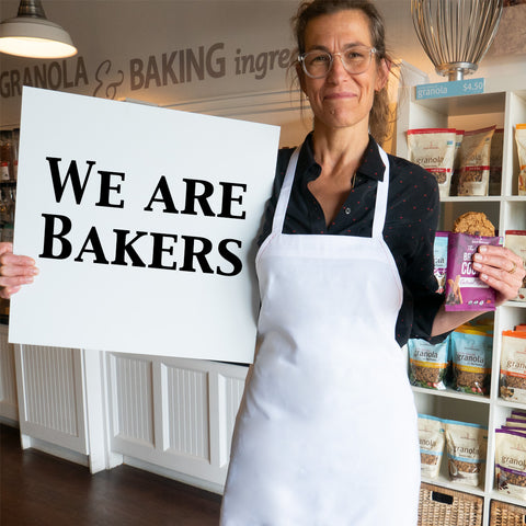 Erin holding a We Are Bakers sign