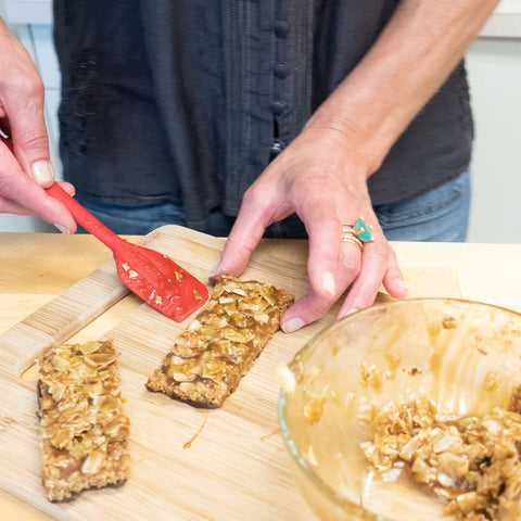 Adding caramel coconut layer to Samoa bar