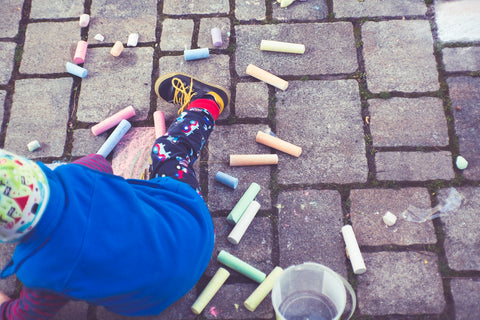 kid playing with chalk