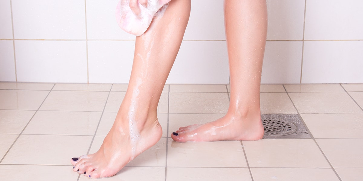 Woman Washing Her Legs With Sponge In Shower. Non Slip ...
