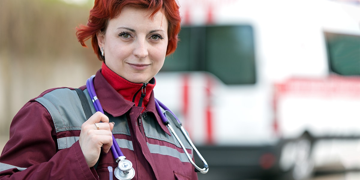emergency medical technical good looking woman with stethoscope.