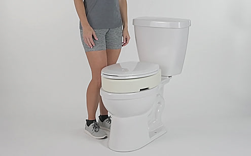toilet seat riser installed on toilet