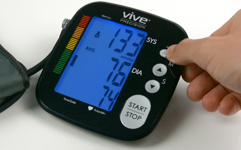 Pressing mode button of the blood pressure monitor
