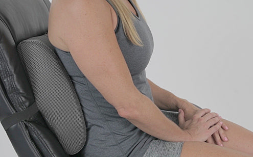 Woman seating with back support pillow