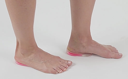 gel heel cups placed under woman's feet