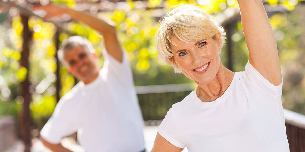 Active senior woman exercising with husband