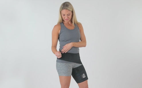 Middle age woman fastening groin support