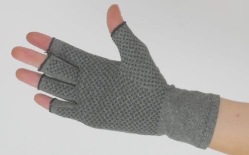 Right hand wearing arthritis gloves with grips