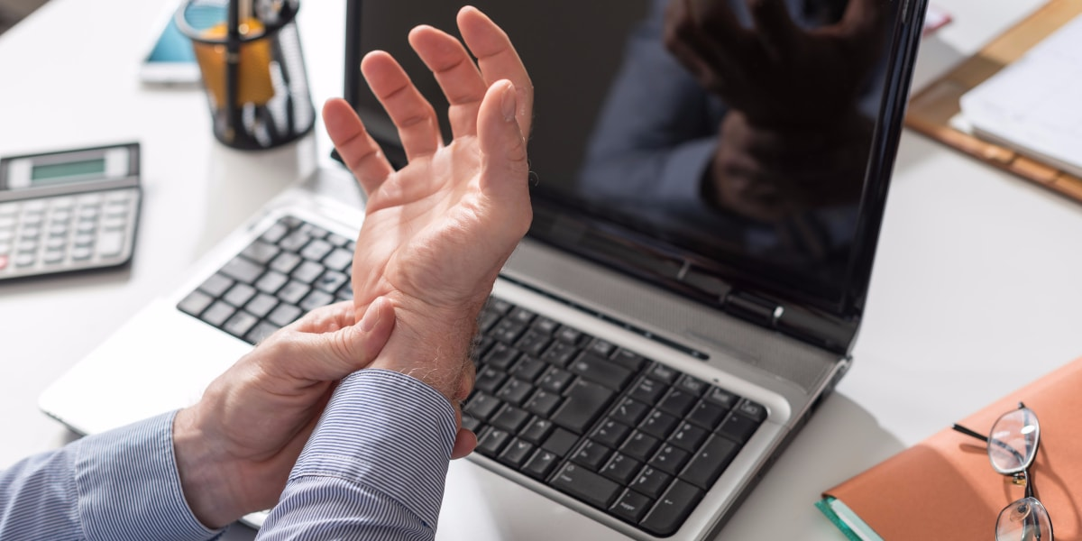 Businessman suffering wrist pain office