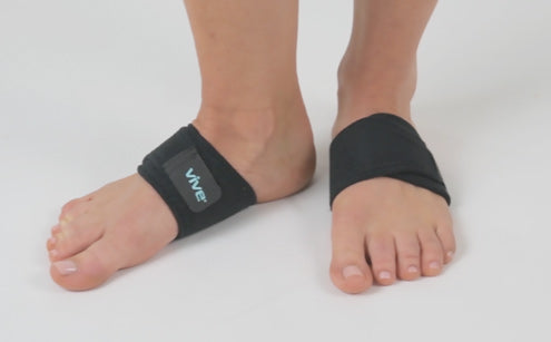 Feet wearing arc support