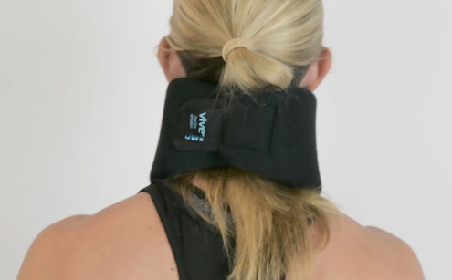 Woman wearing neck brace back view