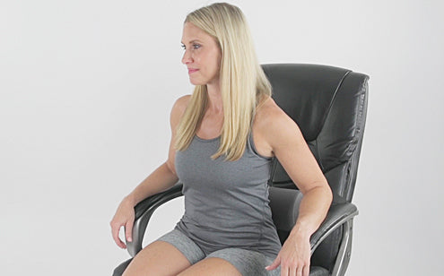sitting in chair with lumbar roll support