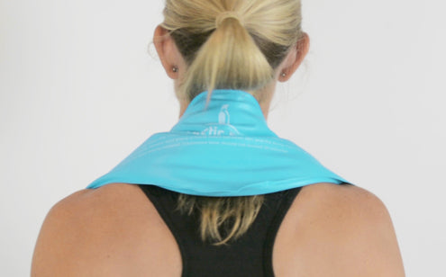 Woman using neck ice pack back view