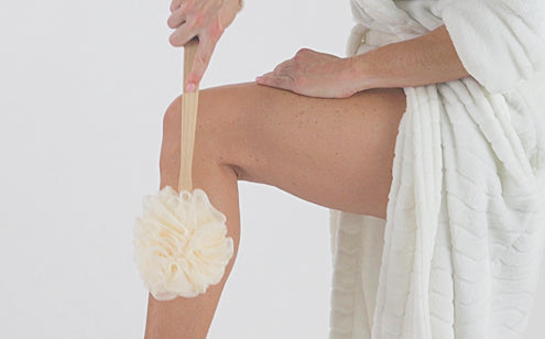scrubbing leg with loofah