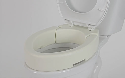 close up image of toilet seat riser attached to toilet