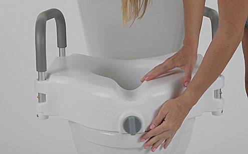 hands res positioning raised seat on toilet