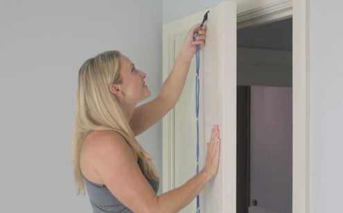 Woman installing shoulder pulley Rope putting on the door