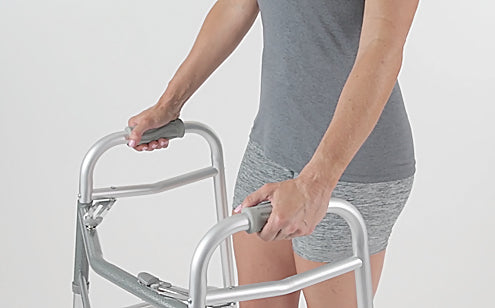 hands placed on contoured walker grips