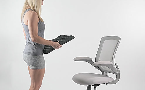 Middle age woman holding a max gel seat cushion