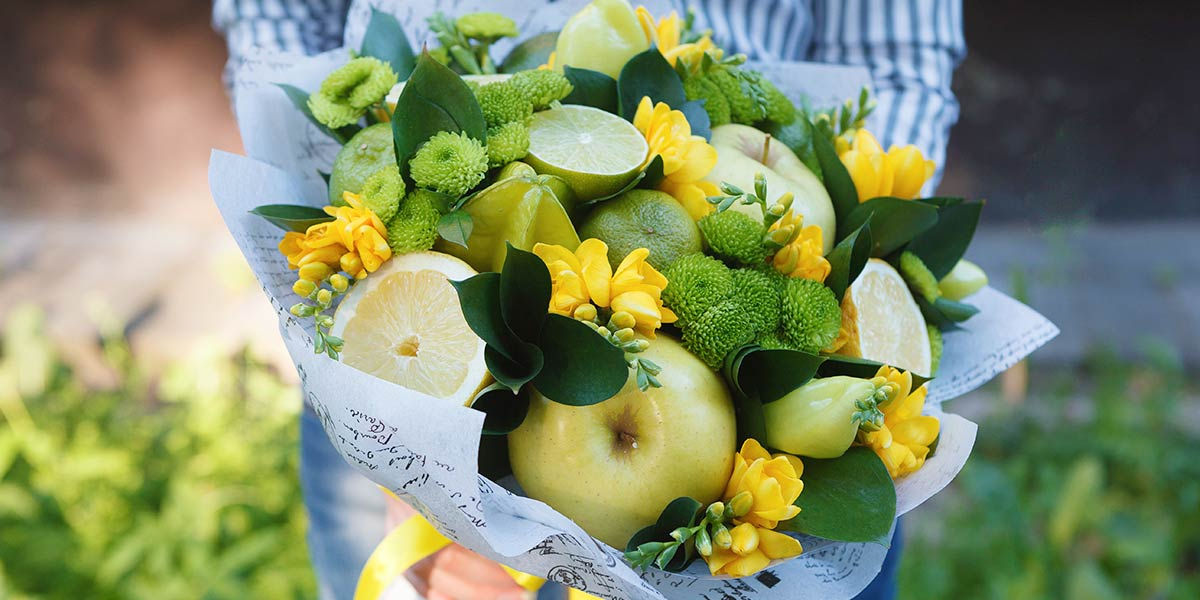 Fruit and with flower arrangement