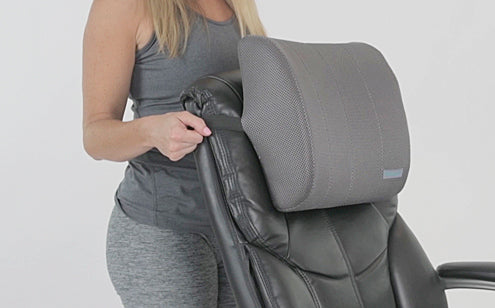 Woman putting seat pillow