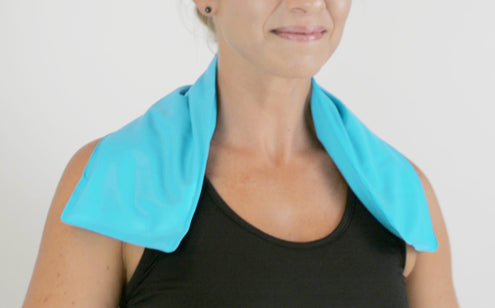Smiling woman using neck ice pack