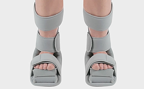 Feet wearing soft night splint