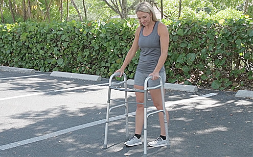 woman walking outside with folding walker