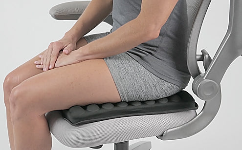 Woman sitting in a chair with max gel seat cushion