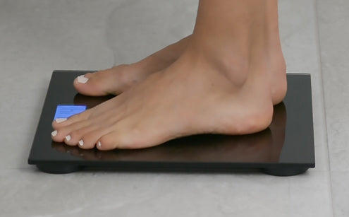 Stepping in digital bathroom scale