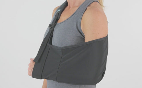 Woman using arm sling