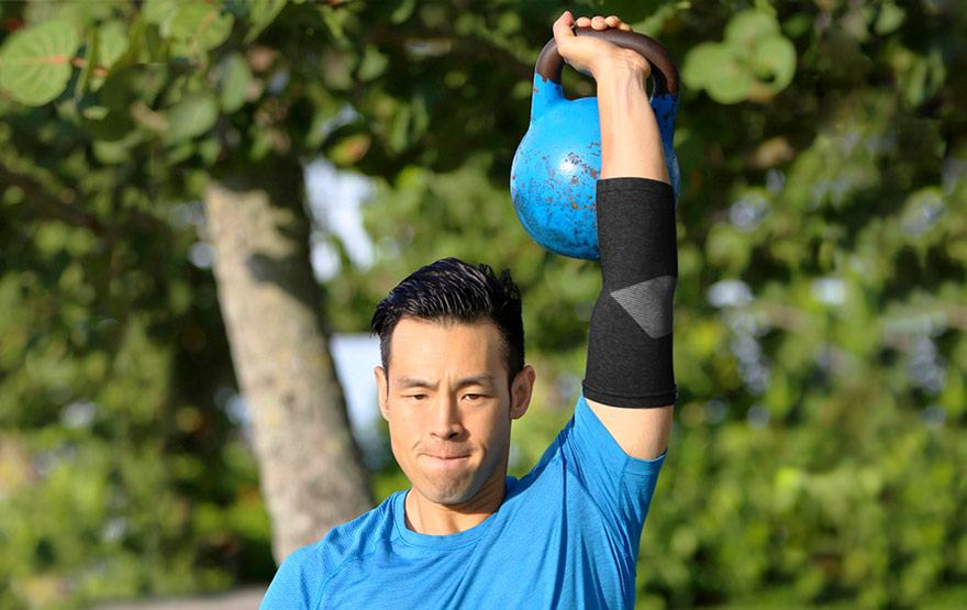 man lifting kettle bell