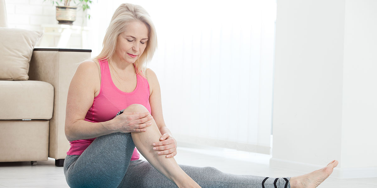 Middle-aged woman suffering from pain in leg