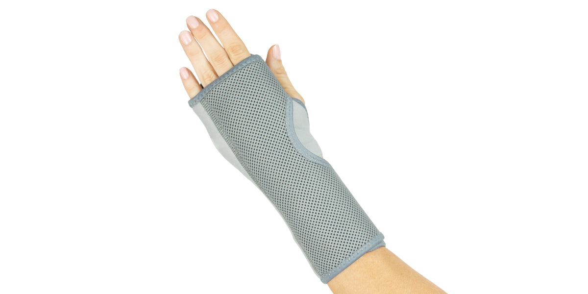 Hand wearing night time wrist brace by Vive