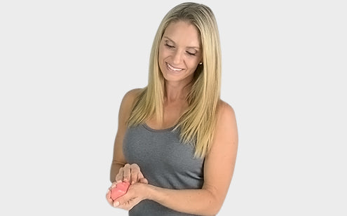 Smiling middle age woman using therapy putty