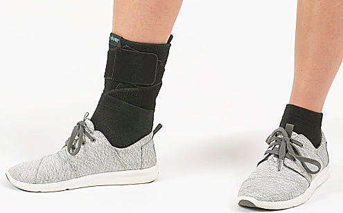 Wearing shoes with ankle brace support