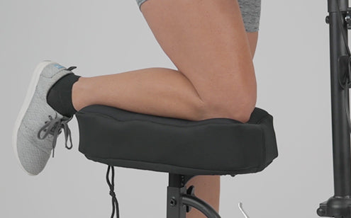 Knee resting on memory foam knee scooter pad