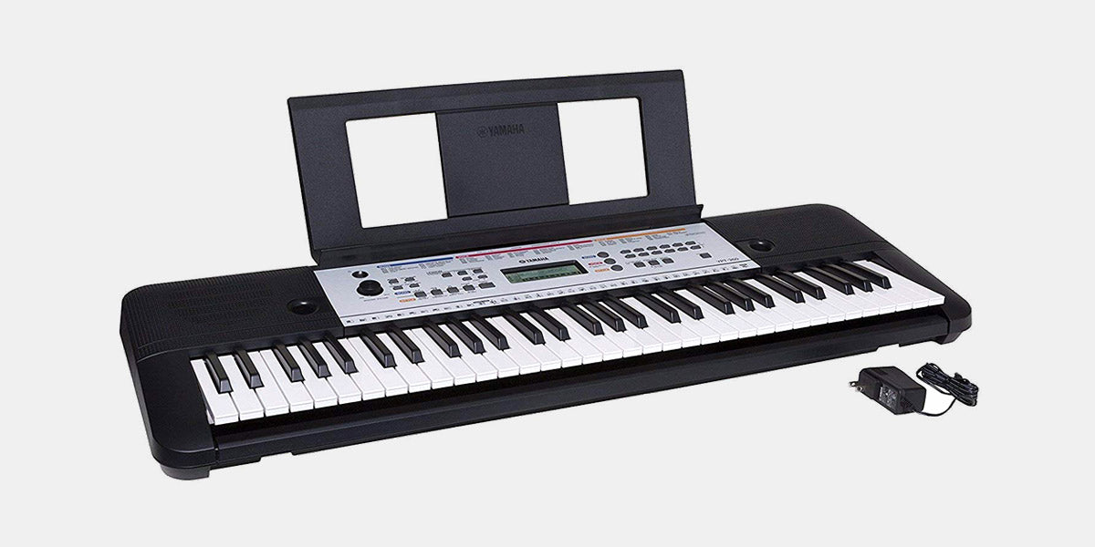 Portable Keyboard with Power Adapter by Yamaha